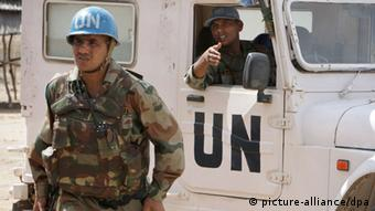 A soldier wearing the UN blue helmet with a UN truck in the background EPA/STUART PRICE