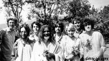 Maharishi Mahesh Yogi with members of the Beatles and other famous followers, who have chosen to study transcendental meditation at his academy in India, March 1968. Included in the group are, from left to right; unknown, John Lennon (1940 - 1980), Paul McCartney, Maharishi Mahesh Yogi, George Harrison (1943 - 2001), Mia Farrow, unknown, and Donovan. (Photo by Keystone Features/Hulton Archive/Getty Images)