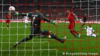 Mario Mandzukic (2nd R) of Bayern Munich scores the opening goal against Naldo (R) of Wolfsburg and his keeper Diego Benaglio during the DFB Cup Semi Final match between Bayern Muenchen and VfL Wolfsburg at Allianz Arena on April 16, 2013 in Munich, Germany. (Photo: Alexander Hassenstein/Bongarts/Getty Images)