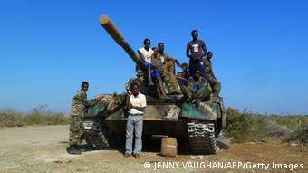A picture taken on March 2, 2012 shows Ethiopian troops standing on an army tank at an air base in the city of Baido, which was taken over from Shebab rebels on February 22. Truckloads of Ethiopian and Somali troops on February 22 captured the strategic Somali city of Baidoa from Al-Qaeda-allied Shebab insurgents, who vowed to avenge their biggest loss in several months. Baidoa, 250 kilometres (155 miles) northwest of the capital Mogadishu, was the seat of Somalia's transitional parliament until the hardline Shebab captured it in 2009. Ethiopia says it is in the country to support Somalia?s transitional government to stamp out Shebab insurgents, but says it does not plan to remain in the country for the long term. AFP PHOTO / JENNY VAUGHAN (Photo credit should read JENNY VAUGHAN/AFP/Getty Images)