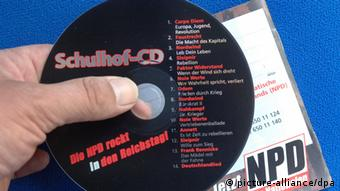 A CD of far right music distributed in schools Photo: Peer Grimm dpa/lbn