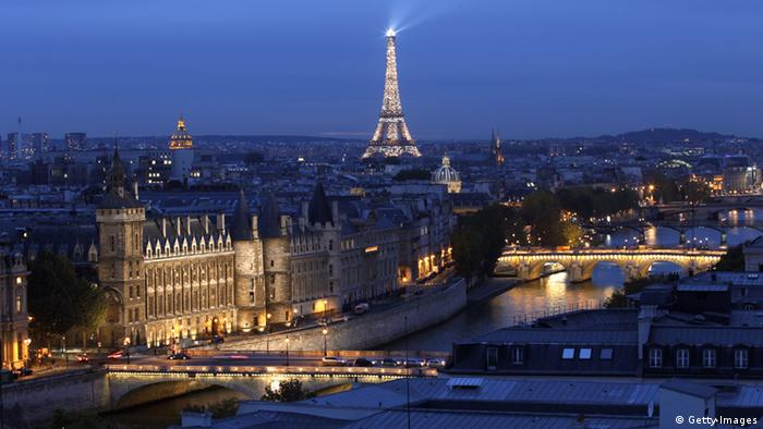 A picture taken from the roof of Paris' city hall shows bridges along the Seine River in front of the Eiffel Tower in Paris