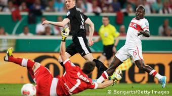 Jan Rosenthal (C) of Freiburg scores his team's first goal during the DFB Cup Semi Final match between VfB Stuttgart and SC Freiburg at Mercedes-Benz Arena (Photo by Joern Pollex/Bongarts/Getty Images)