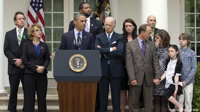 President Barack Obamais joined by former Rep. Gabby Giffords, second from left, Vice President Joe Biden, and Newtown family members (Photo via AP)