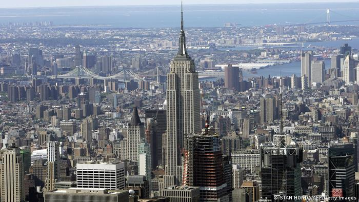 The Empire Building in the middle of the canyons of Manhattan.  In the background the Hudson River