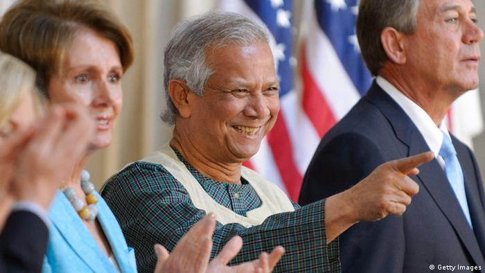 Bangladeshi economist Muhammad Yunus (C) points to an audience member as he arrives for the Congressional Gold Medal presentation ceremony with House Minority Leader Nancy Pelosi (L), D-CA, and House Speaker John Boehner (R), R-OH, on April 17, 2013 in the Rotunda of the US Capitol in Washington, DC. Yunus received the award for his efforts in fighting global poverty. AFP PHOTO/Mandel NGAN. (Photo credit should read MANDEL NGAN/AFP/Getty Images)