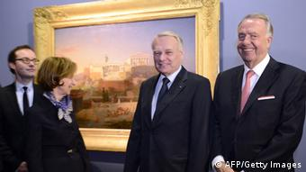 French Prime Minister Jean-Marc Ayrault (C), German Culture Minister Bernd Neumann (R), and Brigittte Ayrault at the Louvre museum in Paris . AFP PHOTO / POOL / BERTRAND GUAY (Photo credit should read BERTRAND GUAY/AFP/Getty Images)