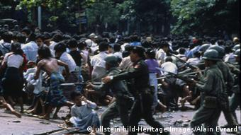 Burmese soldiers clearing the streets during a crackdown on pro democracy demonstrators in 1988, Rangoon, Myanmar. (Photo: ullstein bild-Heritage Images/Alain Evrard)