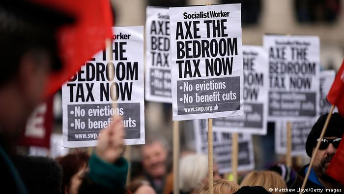 Protestors hold signs as they demonstrate against the proposed 'bedroom tax'