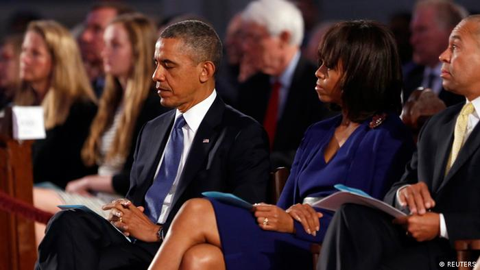 U.S. President Barack Obama and first lady Michelle Obama attend an interfaith memorial service at the Cathedral of the Holy Cross (Photo: REUTERS/Kevin Lamarque)