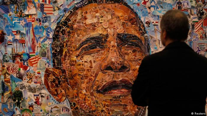 A visitor looks at the artwork 'Obama' by Vik Munoz from Ben Brown Fine Arts gallery at the Art Cologne fair in Cologne April 18, 2013. Some 200 international exhibitors take part in the 47th Cologne Art fair. REUTERS/Ina Fassbender (GERMANY - Tags: ENTERTAINMENT)