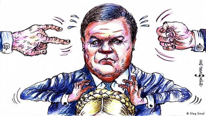 Карикатура Олега Смаля. Президент Янукович держит руки над прической Юлии Тимошенко.