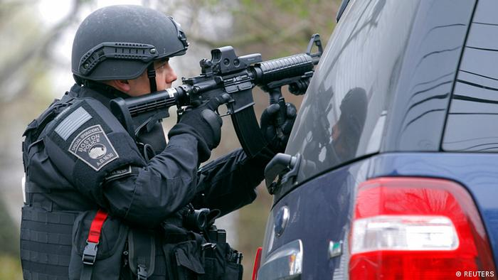 A member of the SWAT team trains a gun in Boston. Photo: Reuters