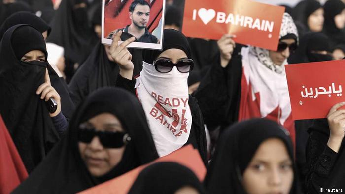 A protester holds a banner as she participates in an anti-government rally organised by main opposition group Al Wefaq in Budaiya, west of Manama April 19, 2013. The banner reads as Free Nasser Al Jishi, arrested 18/3/2011, sentenced to 8 yrs. (Photo: REUTERS/Hamad I Mohammed)