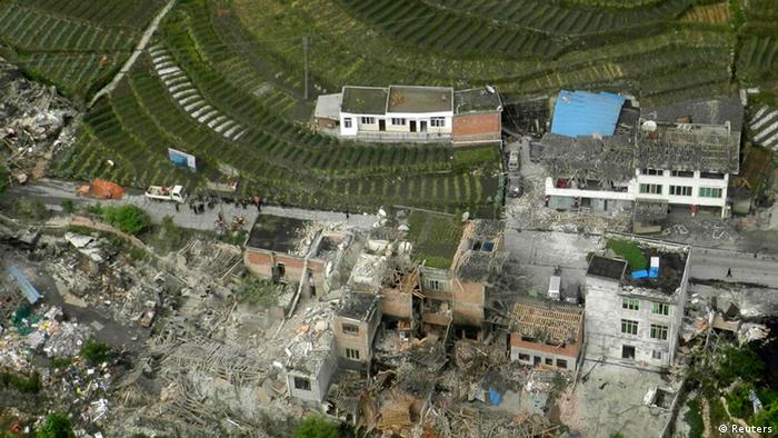An aerial view shows houses damaged after a strong earthquake in Lushan county, Ya'an, Sichuan province, April 20, 2013. At least fifty-six people were killed and more than 500 others injured in the earthquake, according to Xinhua News Agency. REUTERS/China Daily (CHINA - Tags: DISASTER ENVIRONMENT TPX IMAGES OF THE DAY) CHINA OUT. NO COMMERCIAL OR EDITORIAL SALES IN CHINA