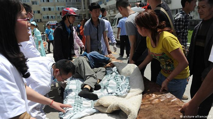 A victim injured in an earthquake receives medical treatment at a temporary treatment station in Lushan county in Ya'an in southwest China's Sichuan province on Saturday, April 20, 2013. A magnitude-7 earthquake jolted Lushan county in China's Sichuan province Saturday near where a devastating quake struck five years ago, leaving at least 78 dead and more than 600 injured.(Photo By Zhang Lang/Color China Photo/AP Images)