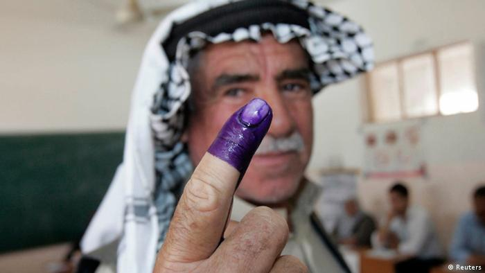 An internally displaced Iraqi man shows his ink-stained finger to the media after voting at a polling centre during the country's provincial elections in Kirkuk, 250 km (155 miles) north of Baghdad, April 20, 2013. (Photo: REUTERS/Ako Rasheed)