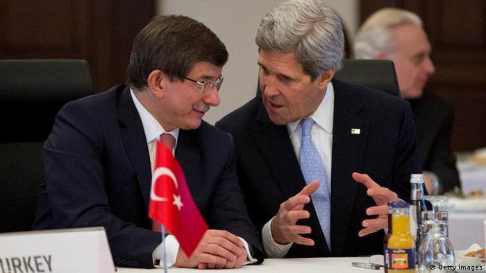 ISTANBUL, TURKEY - APRIL 20: U.S. Secretary of State John Kerry, right, talks with Turkish Foreign Minister Ahmet Davutoglu during a Friends of Syria group meeting hosted by Davutoglu at the Adile Sultan Palace April 20, 2013 in Istanbul, Turkey. Kerry is expected to announce a significant expansion of non-lethal aid to the Syrian opposition. (Photo by Evan Vucci-Pool/Getty Images)