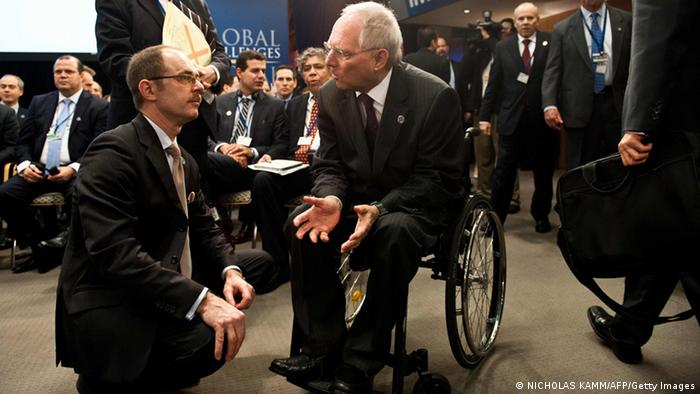 German Finance Minister Wolfgang Schäuble speaks to an advisor in Washington
