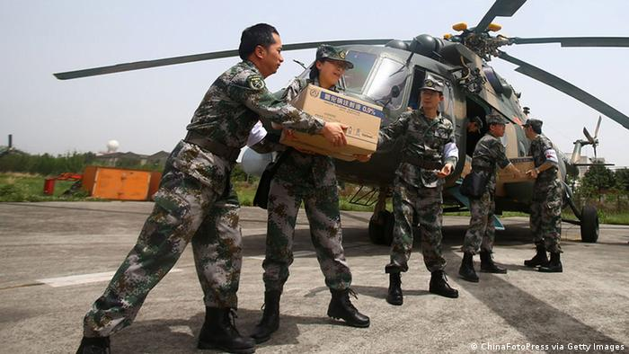 Rescue workers load relief supplies onto a helicopter to be transported to the earthquake-hit area of Lushan county, at Chengdu airport in China. (Photo: China Foto Press/Getty Images)