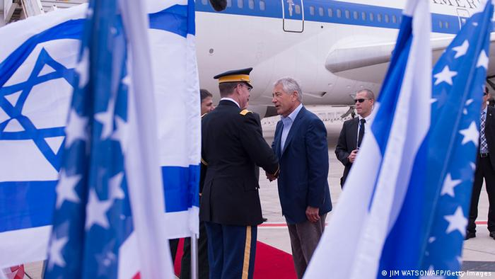 US Secretary of Defense Chuck Hagel (R) shakes hands with dignitaries as he arrives in Tel Aviv, Israel on April 21, 2013. Asked if a multi-billion dollar arms package with Israel was designed to convey a message that a military strike remains an option, Hagel said before landing in Tel Aviv: I don't think there's any question that's another very clear signal to Iran. AFP PHOTO/POOL/JIM WATSON (Photo credit should read JIM WATSON/AFP/Getty Images)