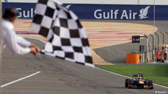 Red Bull Formula One driver Sebastian Vettel of Germany crosses the finish line at the Bahrain F1 Grand Prix at the Sakhir circuit, south of Manama April 21, 2013. (Photo: REUTERS/Darren Whiteside)