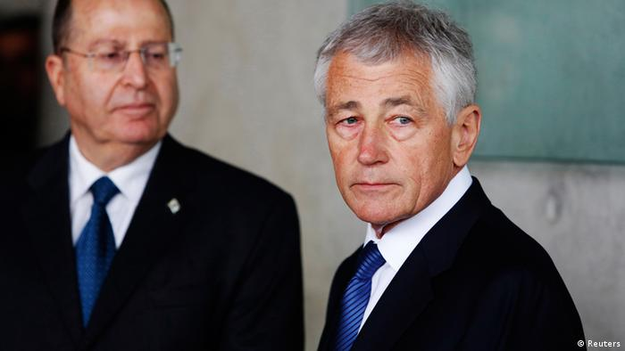 U.S. Secretary of Defense Chuck Hagel (R) stands next to Israel's Defence Minister Moshe Yaalon during his visit at the Yad Vashem Holocaust Memorial in Jerusalem April 21, 2013. Hagel said on Sunday a $10 billion arms deal planned with Arab and Israeli allies sent a very clear signal to Iran that military options remain on the table over its nuclear programme. REUTERS/Baz Ratner (JERUSALEM - Tags: POLITICS MILITARY)