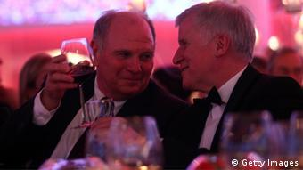 Uli Hoeness talks to Horst Seehofer, Chairman of the Christian Social Union (CSU), the Bavarian Christian Democrats political party at Uli Hoeness' 60th birthday celebration at Postpalast on January 13, 2012 in Munich, Germany. (Photo: Alexandra Beier/Bongarts/Getty Images)