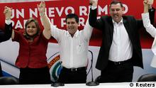 Paraguayan presidential candidate Horacio Cartes (C) of the Colorado Party raises his arms in the air with the party's president Lilian Samaniego (L) and member Javier Zacarias Irun after a news conference during the presidential elections in Asuncion, April 21, 2013. Paraguayans began voting on Sunday in a presidential election that could return the center-right Colorado Party to power less than a year after the nation's first leftist leader was impeached. REUTERS/Jorge Adorno (PARAGUAY - Tags: POLITICS ELECTIONS)
