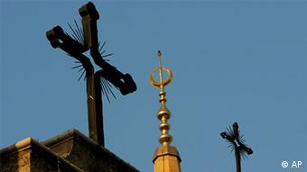 A minaret of the Mohammed al-Amin Mosque and two crosses on top of the Maronite St George Cathedral are seen in downtown Beirut, Lebanon, Sunday, Sept. 17, 2006. Authorities in Lebanon, where Christians account for the highest percentage of population in any Arab nation, have tightened security outside churches as a precaution against possible attacks by militants angered by comments on Islam by the Pope. (AP Photo/Petros Karadjias)