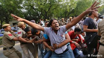 A supporter of Aam Aadmi Party shouts slogans as he and others are detained by police during a protest outside the residence of India's Prime Minister Manmohan Singh (Photo: REUTERS/Adnan Abidi)