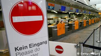 FRANKFURT AM MAIN, GERMANY - APRIL 22: Empty Lufthansa ticket counters are pictured during a nationwide strike by Lufthanda ground, service and maintenance personnel at Frankfurt Airport on April 22, 2013 in Frankfurt, Germany. Workers are demaning pay raises and job guarantees and today's strike has forced Lufthansa to cancel approximately 1700 flights. (Photo by Ralph Orlowski/Getty Images)
