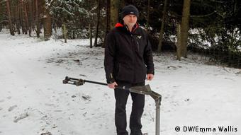 Joachim Kozlowski with his metal detector in the forest near Halbe. (Photo: Emma Wallis)