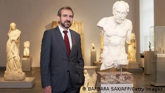 The Prussian Cultural Heritage Foundation's Hermann Parzinger standing next to a statue (BARBARA SAX/AFP/Getty Images)