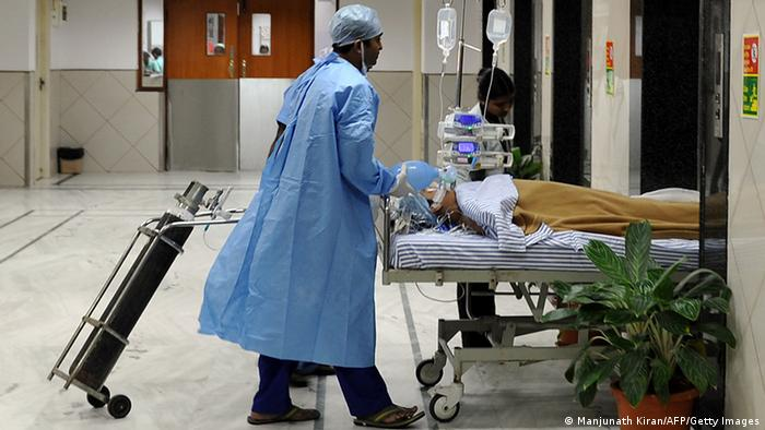 Hospital staff shift a patient the Narayana Hrudayalaya cardiac-care hospital in Bangalore (Photo: Manjunath Kiran/AFP/Getty Images)