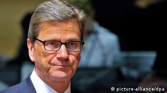 epa03672845 German Foreign Minister Guido Westerwelle awaits the start of an EU Foreign Affairs Council at the EU Headquarters in Luxembourg, 22 April 2013. The European Union is to lift sanctions relating to oil exports and imports to opposition-controlled parts of Syria until 01 June 2013, according to a draft document to agreed by the bloc's foreign ministers on 22 April 2013. EPA/NICOLAS BOUVY