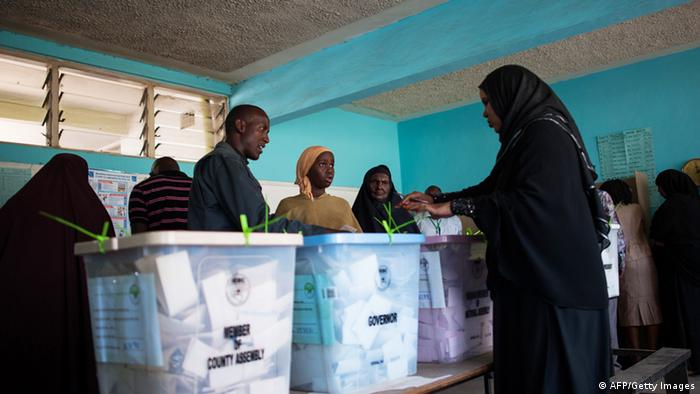 African voters casting their ballots PHIL MOORE/AFP/Getty Images