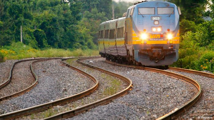 A Via Rail Canada passenger train pulls into Dorval Station in Montreal, in this July 22, 2009 file photo. Canadian police authorities said on Monday they had arrested and charged two men with an al Qaeda-supported plot to derail a passenger train. REUTERS/Shaun Best/Files (CANADA - Tags: BUSINESS POLITICS CRIME LAW)
