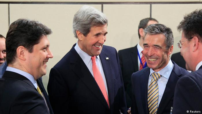 U.S. Secretary of State John Kerry (C) talks with Romania's Foreign Minister Titus Corlatean (L) and NATO Secretary General Anders Fogh Rasmussen at the start of a NATO Foreign Ministers meeting at the Alliance's headquarters in Brussels April 23, 2013. Photo: REUTERS/Yves Herman
