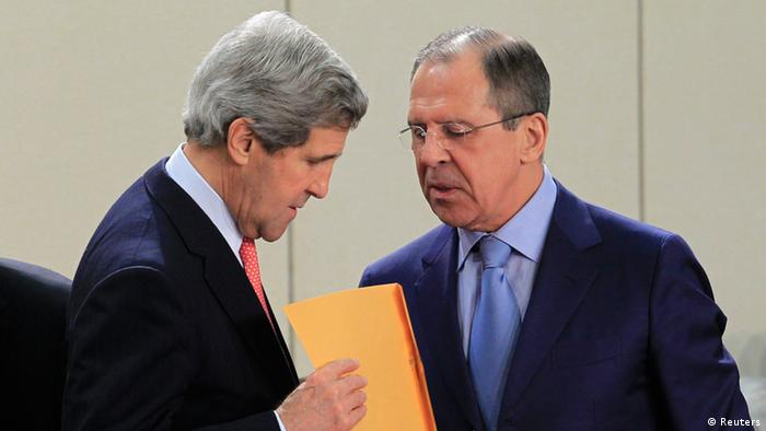 U.S. Secretary of State John Kerry (L) receives an envelope from Russian Foreign Minister Sergei Lavrov at the start of a NATO - Russia foreign ministers meeting at the Alliance's headquarters in Brussels April 23, 2013. REUTERS/Yves Herman (BELGIUM - Tags: POLITICS)