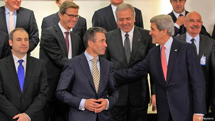 (L-R, first row) Albania's Foreign Minister Aldo Bumci, NATO Secretary General Anders Fogh Rasmussen and U.S. Secretary of State John Kerry, (L-R, second row) Germany's Foreign Minister Guido Westerwelle, his Greek counterpart Dimitrios Avramopoulos and Hungary's Foreign Minister Janos Martonyi pose for a family photo during a NATO foreign ministers meeting at the Alliance's headquarters in Brussels April 23, 2013. REUTERS/Yves Herman (BELGIUM - Tags: POLITICS)