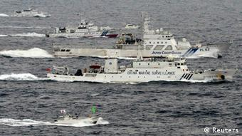 An aerial photo shows a Chinese marine surveillance ship Haijian No. 66 (C) cruising next to Japan Coast Guard patrol ships in the East China Sea, near known as Senkaku isles in Japan and Diaoyu islands in China, in this photo taken by Kyodo April 23, 2013 (Photo: REUTERS/Kyodo)
