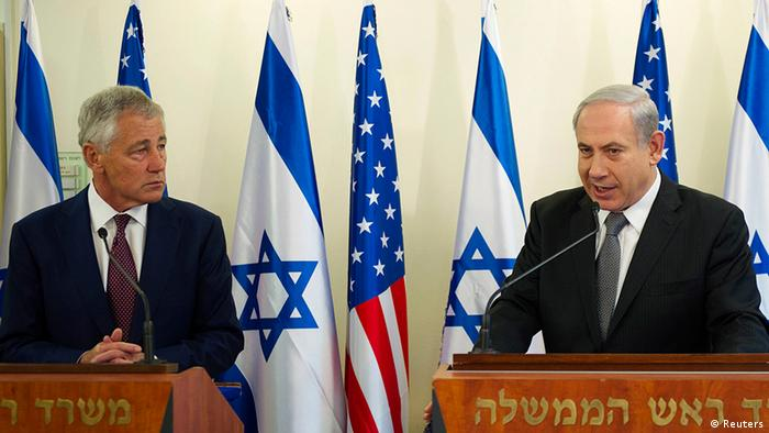 U.S. Defense Secretary Chuck Hagel (L) and Israel's Prime Minister Benjamin Netanyahu hold a joint news conference in Jerusalem April 23, 2013. Israel suggested on Monday it would be patient before taking any military action against Iran's nuclear programme, saying during a visit by U.S. Defense Secretary Chuck Hagel there was still time for other options. REUTERS/Jim Watson/Pool (JERUSALEM - Tags: POLITICS MILITARY)