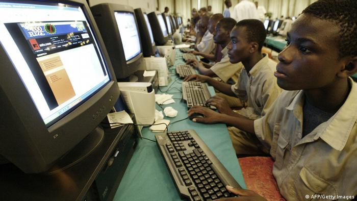 Young Ivorians learning how to use a computer in Abidjan (Copyright: ISSOUF SANOGO/AFP/Getty Images)