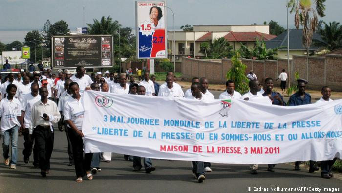 Burundian journalists carry a banner as they march in the streets of Burundi's capital Bujumbura on May 03, 2011. Hundreds of journalist joined the march to mark the International day of the freedom of the press and called for the release of a fellow journalist, Jean-Claude Kavumbagu, who was arrested by the Burundian authorities and accused of treason for having doubted the Burundian governments ability to prevent a somali Islamist insurgents attack on Burundian soil. The prosecutor in the case is asking for life imprisonment as punishment for the journalist's offense. Burundi is one of the two countries who have provided soldiers to the African Union's military force helping to uphold the Somali transitional government. AFP PHOTO/ESDRAS NDIKUMANA (Photo credit should read Esdras Ndikumana/AFP/Getty Images)