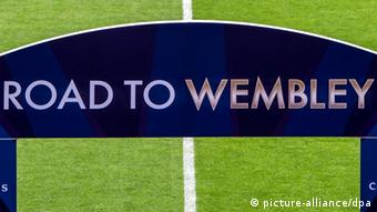 A gate with the words Road to Wembley is seen before the UEFA Champions League semi final first leg soccer match between FC Bayern Munich and FC Barcelona at Fußball Arena Muenchen in Munich, Germany, 23 April 2013. Photo: Marc Müller/dpa +++(c) dpa - Bildfunk+++