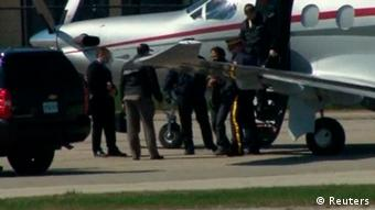 Canadian police escort suspect Chiheb Esseghaier from a plane to a truck after arriving in Markham, Ontario, April 22, 2013, in this still image taken from video courtesy of CTV News. Esseghaier is one of two men charged in Canada with plotting an attack on a passenger train and appeared in separate courts on Tuesday while Iran reacted angrily to police accusations that the plotters were backed by al Qaeda elements in Iran. REUTERS/CTV News/Handout (CANADA - Tags: CRIME LAW POLITICS SOCIETY) NO SALES. NO ARCHIVES. FOR EDITORIAL USE ONLY. NOT FOR SALE FOR MARKETING OR ADVERTISING CAMPAIGNS. THIS IMAGE HAS BEEN SUPPLIED BY A THIRD PARTY. IT IS DISTRIBUTED, EXACTLY AS RECEIVED BY REUTERS, AS A SERVICE TO CLIENTS