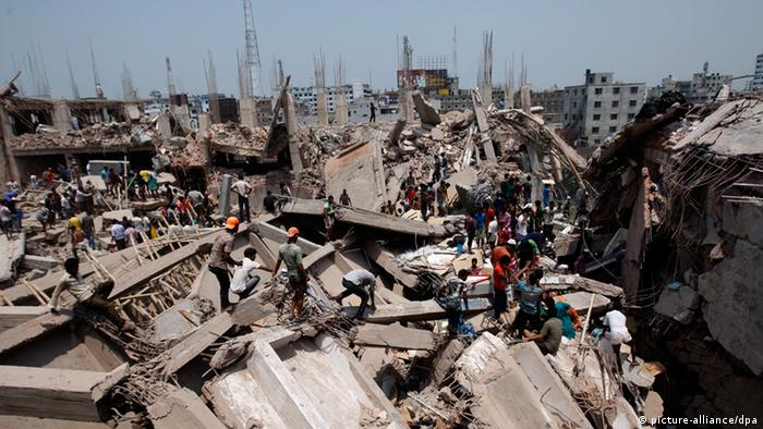 Civilians take part in the rescue operation after an eight-storey building Rana Plaza collapsed at Savar in Dhaka, Bangladesh 24 April 2013. At least 20 people died including garment workers and many more were critically injured, reports said. (Photo: EPA/ABIR ABDULLAH)
