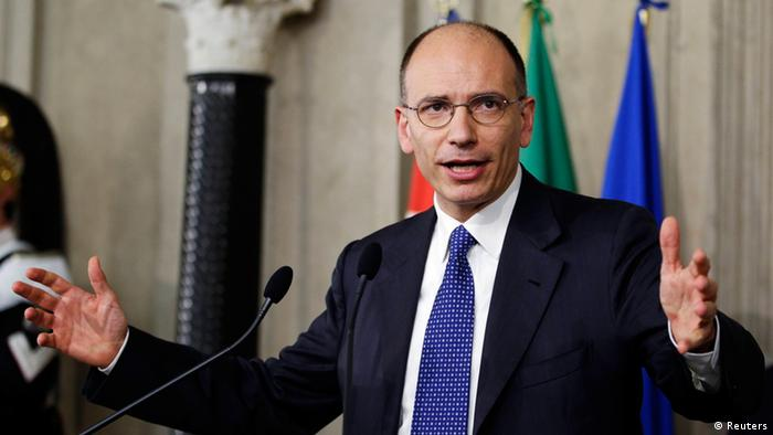 Deputy leader of Italy's centre-left Democratic Party (PD) Enrico Letta gestures as he speaks to reporters at the Quirinale Palace in Rome April 24, 2013. Italian President Giorgio Napolitano on Wednesday asked Letta to form a new government, signalling the end of a damaging two-month vacuum since elections in the euro zone's third largest economy in January. REUTERS/Max Rossi (ITALY - Tags: POLITICS ELECTIONS)