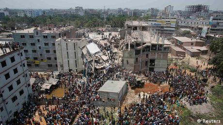 Crowds gather at the collapsed Rana Plaza building as people rescue garment workers trapped in the rubble, in Savar, 30 km (19 miles) outside Dhaka April 24, 2013. (Photo: REUTERS/Andrew Biraj)
